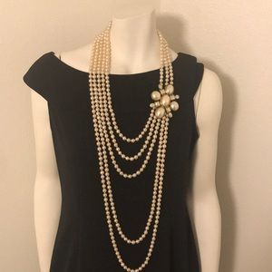 Authentic CHANEL pearl necklace and brooch.